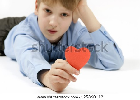 Schoolboy and red heart. - stock photo