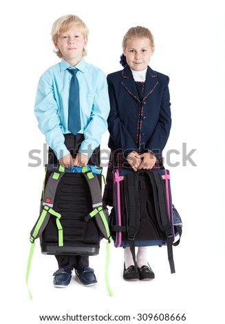 Schoolboy and schoolgirl with schoolbags in hands standing together, isolated on white background - stock photo