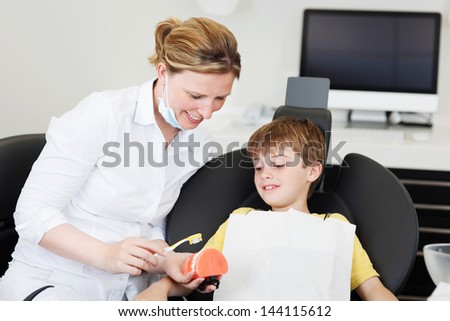 Schoolboy at dentist office during prevention lesson - stock photo