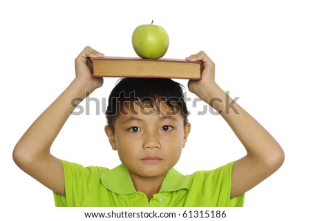 schoolboy books and apple in the head - stock photo