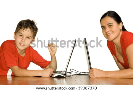Schoolboy clenches his fists in celebration after his achievement on the computer. - stock photo