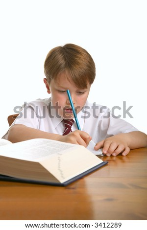 Schoolboy doing his homework, isolated against a white background. - stock photo