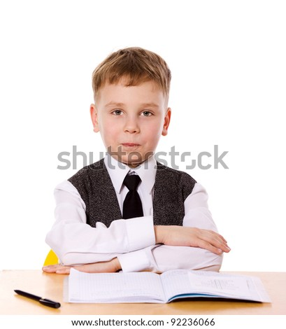 schoolboy doing homework sitting isolated on white