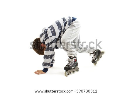 Schoolboy falls over while rollerblading. Isolated on white background - stock photo