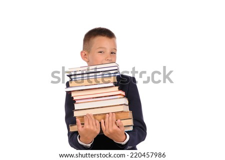 Schoolboy holding huge stack of books  isolated over white background - stock photo