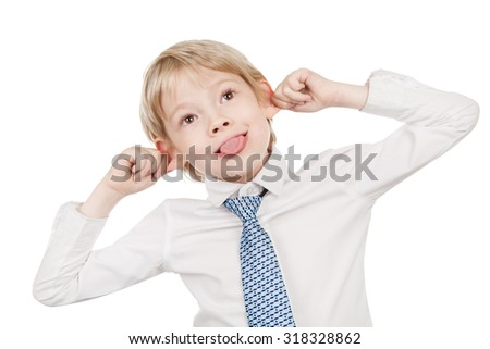 Schoolboy in white shirt fooling around - stock photo