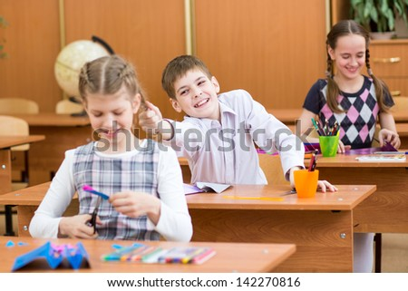 schoolboy indulging during labor lesson - stock photo