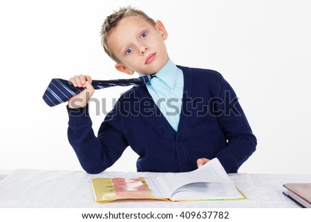 Schoolboy is wearing business clothes  - stock photo