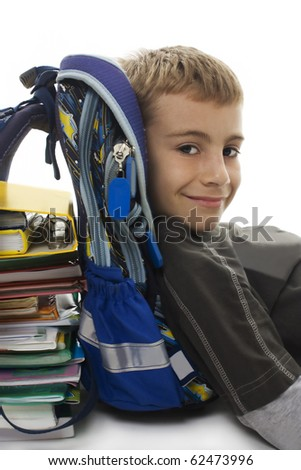 Schoolboy lying on floor, lean on school bag and books isolated on white