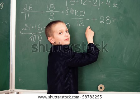 schoolboy on the lesson in a classroom - stock photo