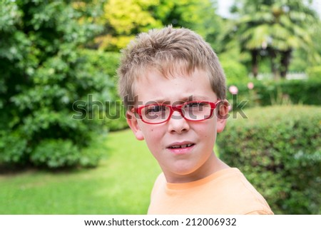 Schoolboy outdoor portrait - stock photo