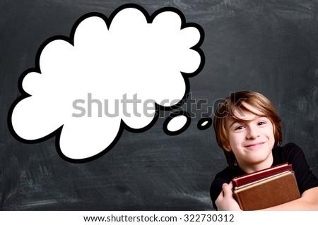 schoolboy over empty school black chalkboard with strip cartoon - stock photo
