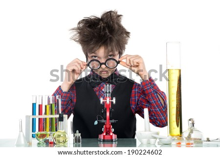 Schoolboy performing a risky experiment with boiling substances, isolated on white - stock photo