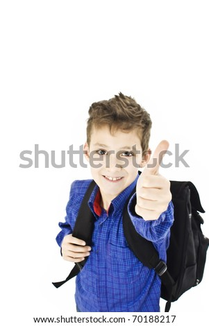 Schoolboy showing OK sign isolated on white - stock photo