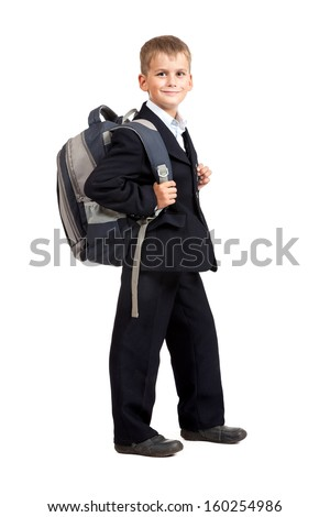 Schoolboy sitting on books isolated on a white background - stock photo