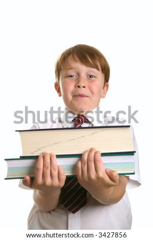 Schoolboy struggling to carry two reference books, isolated on white. - stock photo