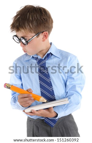 Schoolboy wearing large glasses, holding a book and pencil is looking sideways with much interest.  White background,  - stock photo