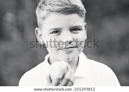 Schoolboy with apple - stock photo