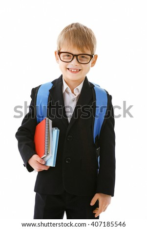 Schoolboy with backpack holding books isolated on white - stock photo