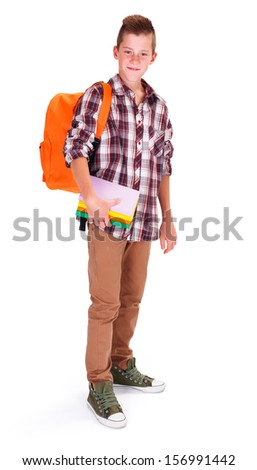 Schoolboy with books and backpack prepared to go back to school