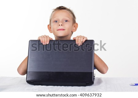 Schoolboy with laptop, isolated on white - stock photo