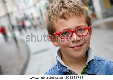 Schoolboy with red glasses outdoor portrait - stock photo