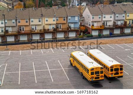 Schoolbuses in a parking, Atlanta, Georgia, USA. - stock photo