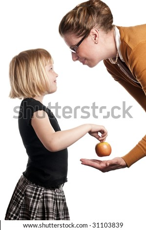 Schoolchild gives teacher apple on white background - stock photo