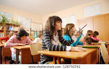 Schoolchildren during lesson in classroom. - stock photo