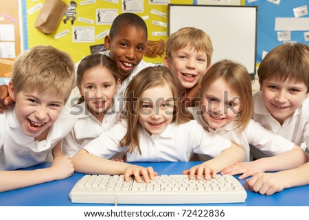Schoolchildren In IT Class Using Computer - stock photo