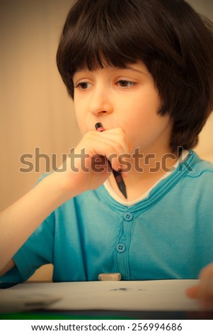 schoole boy portrait with pen. instagram image retro style - stock photo