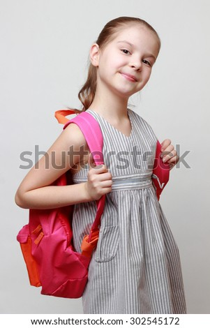 Schoolgirl and school bag - stock photo