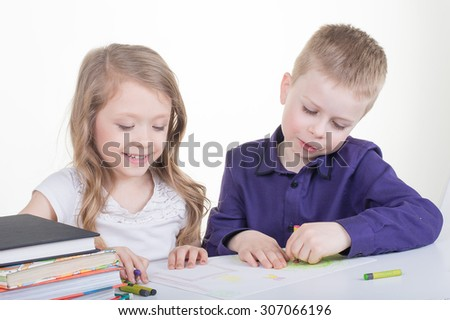 Schoolgirl and schoolboy  do homework