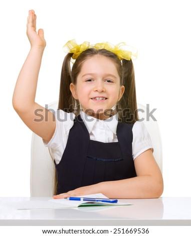 Schoolgirl at her desk isolated - stock photo
