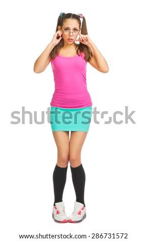 Schoolgirl closes ears isolated on white - stock photo