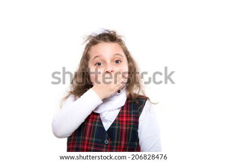 schoolgirl covering her mouth  over white background - stock photo
