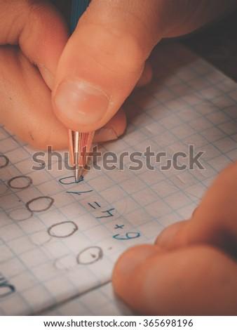 Schoolgirl doing homework. - stock photo