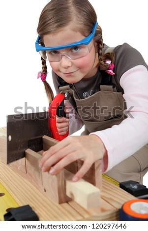 schoolgirl dressed as joiner - stock photo