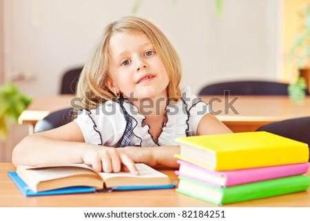 Schoolgirl girl reading books