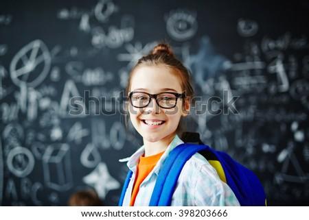 Schoolgirl in eyeglasses - stock photo