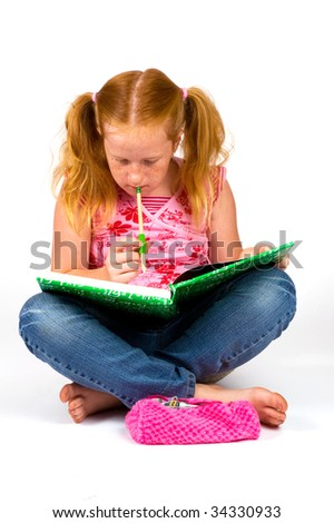schoolgirl is thinking about her homework isolated on white