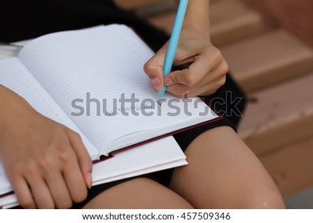 Schoolgirl keeps on lap diary . September 1. Knowledge Day