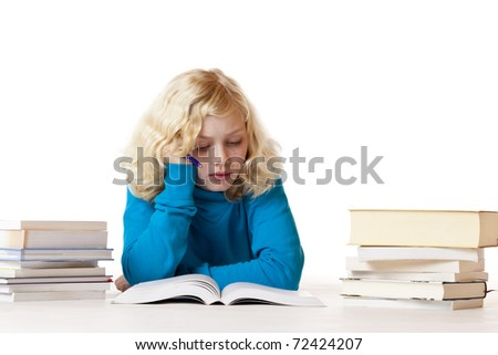 Schoolgirl lying on floor doing homework. Isolated on white background. - stock photo