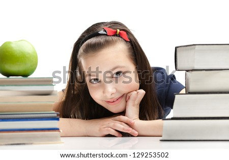 Schoolgirl peeps out through the books, isolated, white background - stock photo