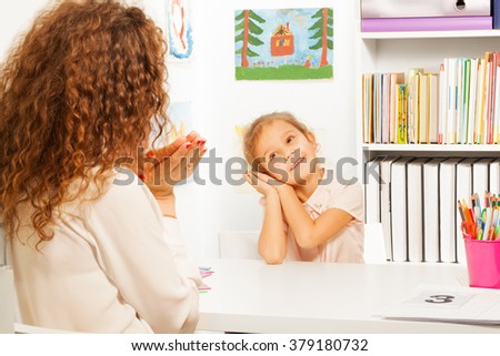 Schoolgirl putting her hands like falling asleep - stock photo