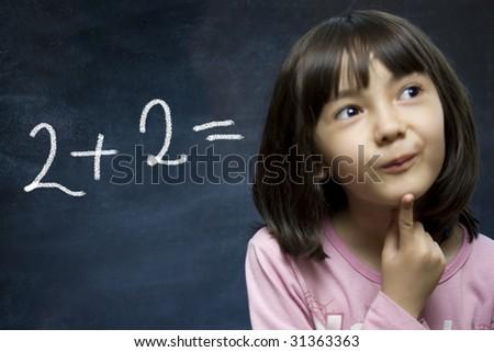 Schoolgirl stay near school blackboard. Close up. - stock photo
