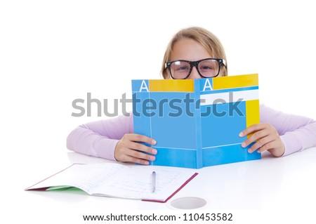 Schoolgirl studing the lesson - stock photo