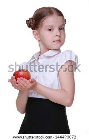 schoolgirl with fresh organic red apple on healthlife theme