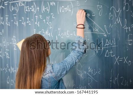 Schoolgirl Glasses Solving Math Problem On Stock Photo (Royalty Free ...