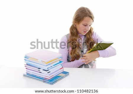 Schoolgirl with the pile of new books - stock photo